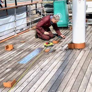 Chris is sealing the deck.