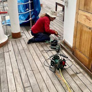 Maggie is also sealing the decks.