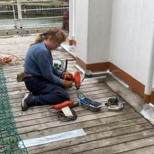 Maggie sealing the decks