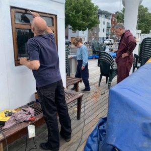 Varnishing the pursers office windows
