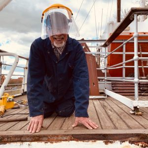 A smile makes everything easier, even deck repairs!